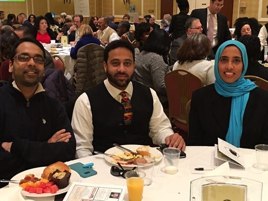 Arif Patel, president of the Islamic Society of Central Jersey; Zeeshan Ali and Azra Baig, both members of the Islamic Society of Central Jersey attend the 19th annual Franklin Township Community Breakfast.