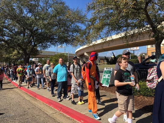 The line snakes around the Bay Center on Saturday afternoon for Day 2 of Pensacon.