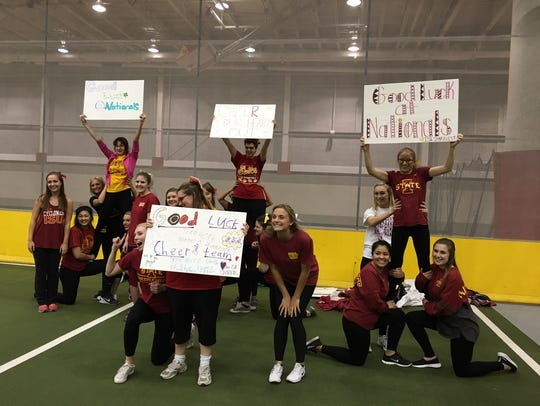 The Cyclone Sparkles practice to cheer on the Iowa