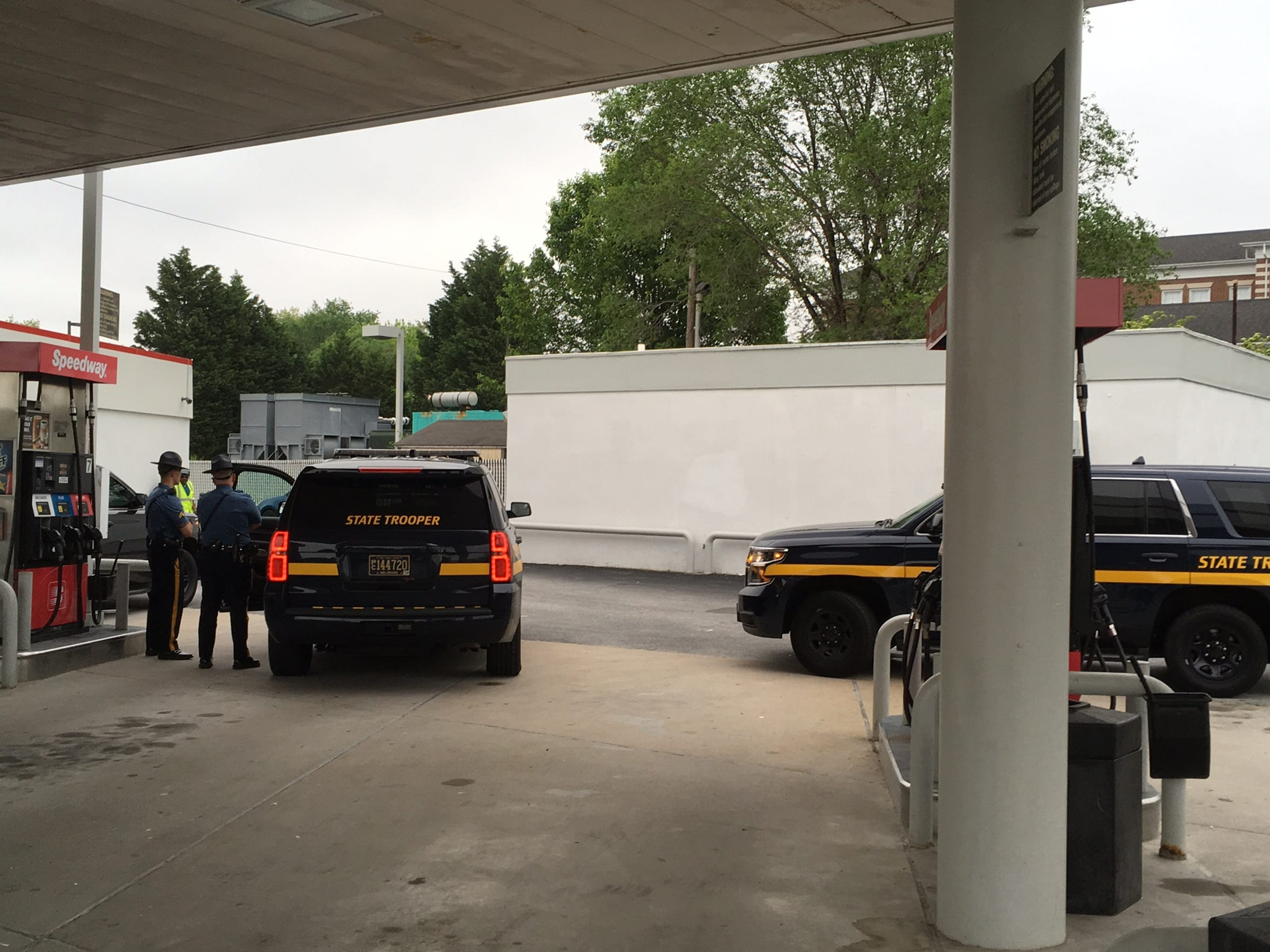 State police investigating a body found in a gas station bathroom near New Castle.