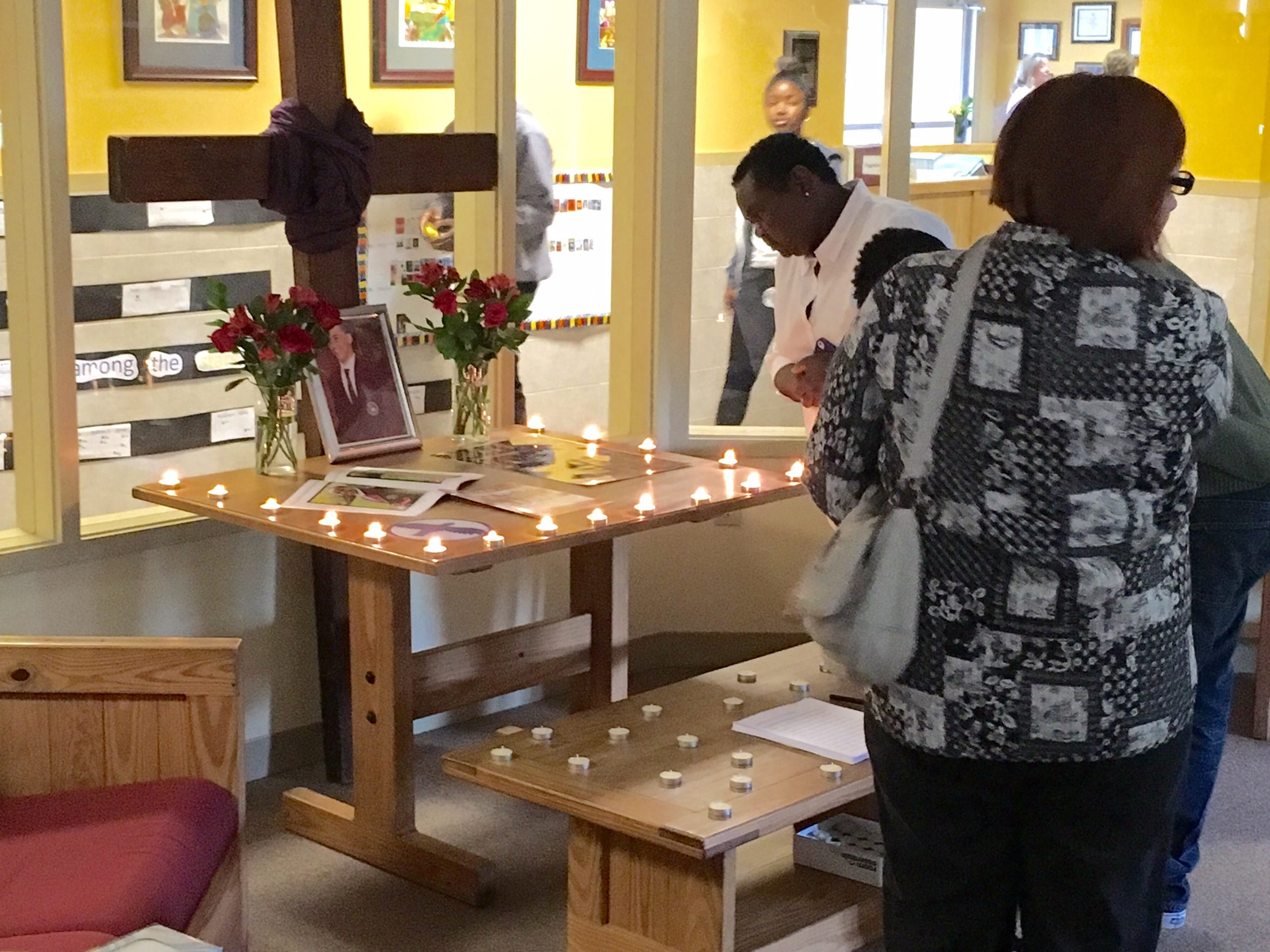 Friends and family attend a private vigil for Brandon Wingo, a Howard High School student shot and killed Thursday, May 19, 2016.