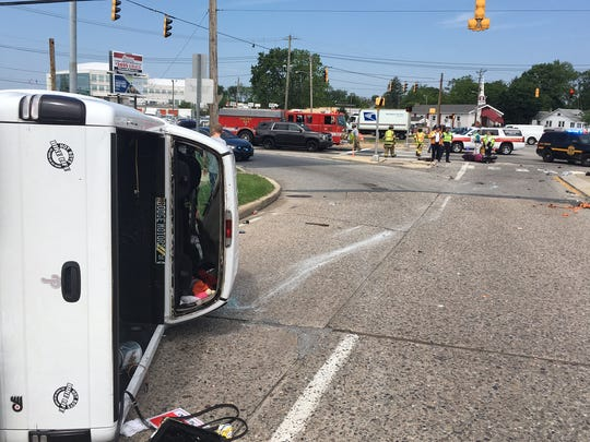 A truck sits on its side after a crash that killed motorcyclist Stephan Mason, 35, of Wilmington, on U.S. 13 in New Castle on May 24. In the distance, first responders are on the scene at the intersection of U.S. 13 and Memorial Drive.