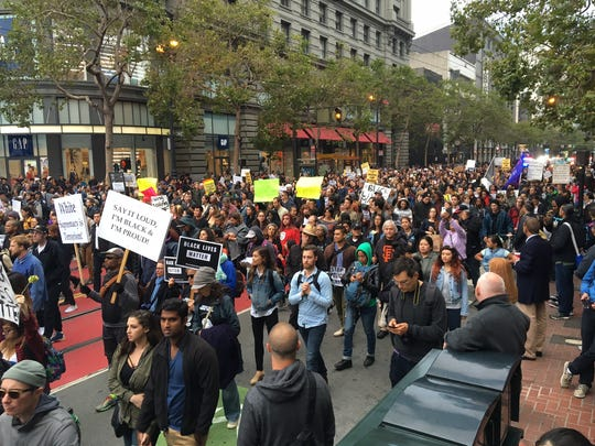 Protesters march along Market St. in San Francisco