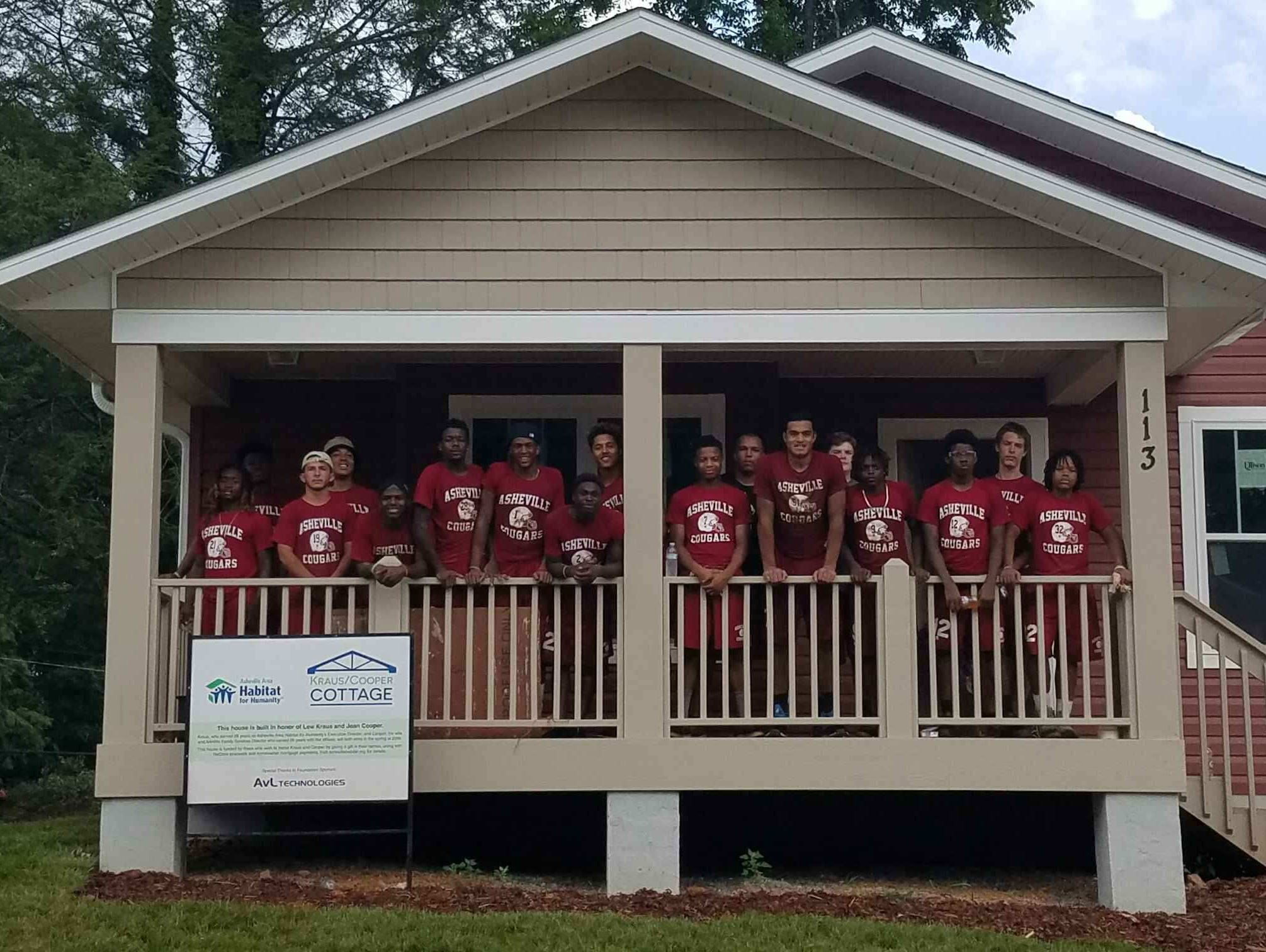 Asheville High football players volunteered their time Saturday for two local charities — Habitat for Humanity and MANNA FoodBank.