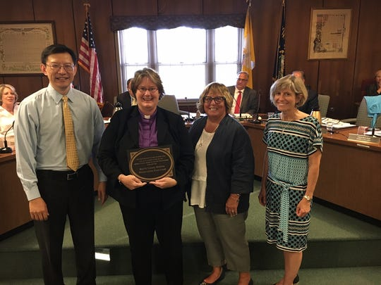 From left, Ray Chang, Rev. Jennifer Van Zandt of the First Presbyterian Church of Boonton, and Freeholders Kathy DeFillippo and Christine Myers at Boonton Town Hall.