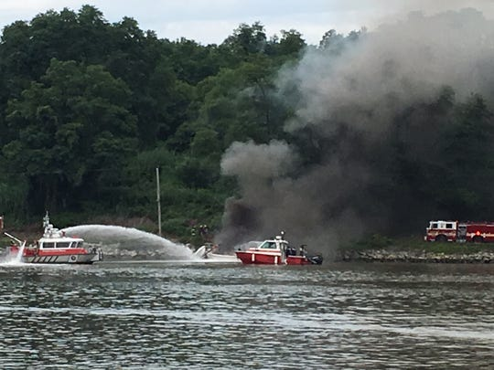 Firefighters battling a boat fire in the Chesapeake and Delaware Canal.
