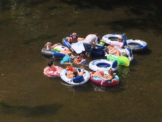 People try to stay cool Sunday by floating down the Brandywine at Thompson's Bridge.