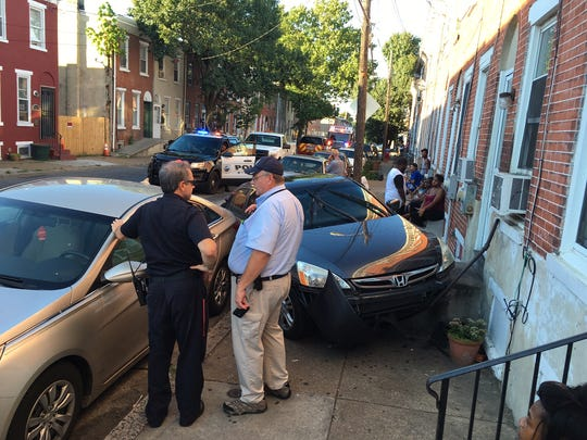 Wilmington police investigate a vehicle crash in the 900 block of Spruce St. on Wednesday, Aug. 17, 2016.