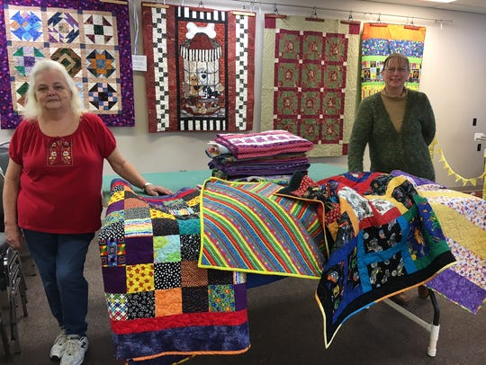 Some quilts made by members of the Ozark Piecemakers Quilt Guild.