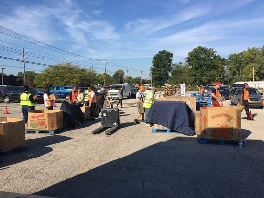 Second Harvest Food Bank volunteers help distribute