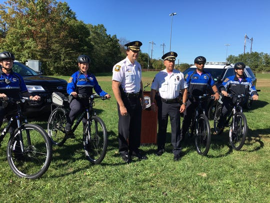 Edison Police Chief Thomas Bryan and Deputy Chief Ronald Mieczkowski join members of the department's new bicycle patrol, a community policing initiative.