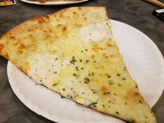 "The ""white"" specialty pizza at Slice Works has ricotta, parmigano, and mozzarella cheeses. There are several Slice Works locations in Denver, Colorado."