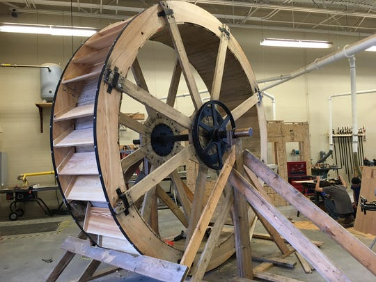 The wooden water wheel is ready to be installed at the Chambers Fort Building.