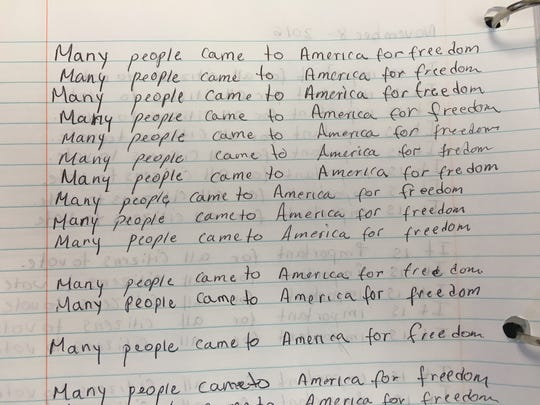 Immigrants studying to be citizens in an Oxnard class practice their English skills. They worry Donald Trump's immigration policies will affect their friends and families.