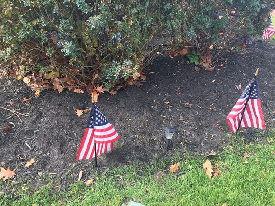 American flags around City Hall Circle in Perth Amboy where Tuesday's news conference about undocumented residents was held.