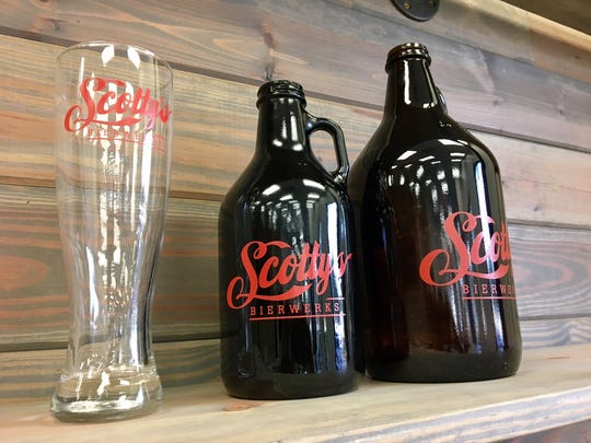 Growlers and glasses line a shelf at Scotty's Bierwerks