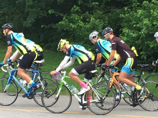 Chad Campbell, center with pink socks, rides with a cycling club in Asheville before an accident Sept. 2 that nearly took his life.