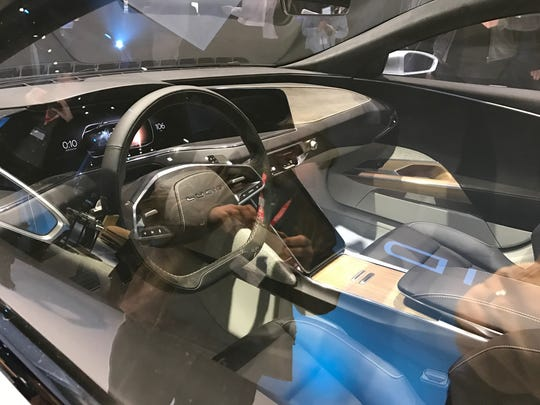 The front seat area of the Lucid Air features a series