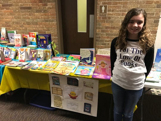 Keira Hacker, a Carmel fifth-grader, collected and donated 1,000 books to Stout Field Elementary just before Christmas.