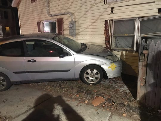 A car came off a trailer and hit a house Monday, Dec. 26, 2016, in Burlington's Old North End. No one was injured.