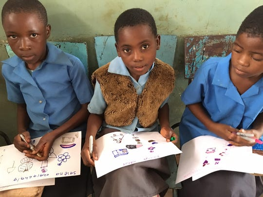 Students from the Demonstration School in Malawi draw