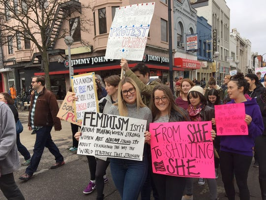 Protesters walk during the Women's March in Ann Arbor