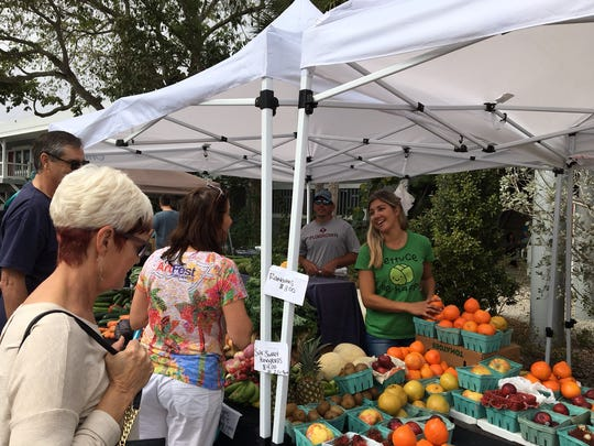 Elizabeth (in green) and Derek Coquillard from Punta Gorda have a farm and produce stand.