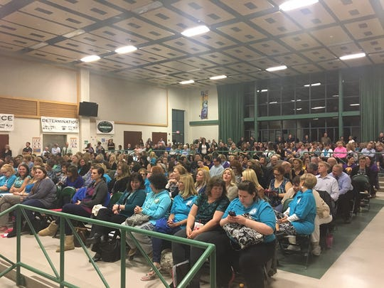 A packed house at DeMasi Middle School listens at Board of Education meeting on Thursday night.