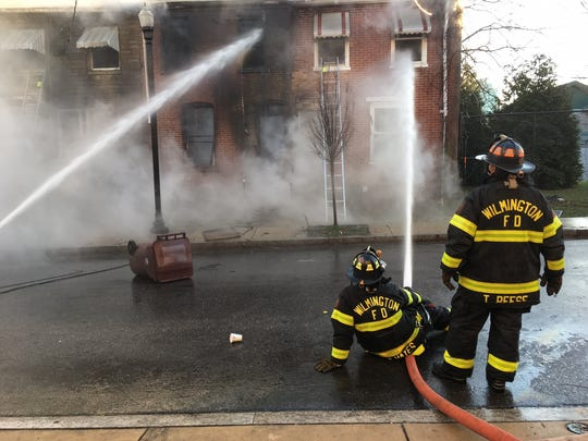 Wilmington firefighters work to extinguish a blaze that broke out on 22nd Street in the city Sunday.