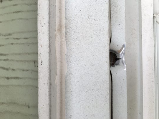 A bullet hole by the front window of a Middlesex Street home in Linden.