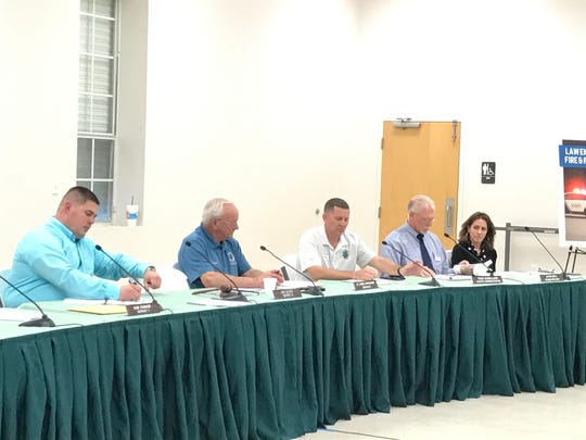 Santa Rosa County Commissioners Sam Parker, left, Don Salter and Lane Lynchard take part in a public meeting on using local option sales tax money with county staff members, county administrator Tony Gomillion, second from right, and county budget director Jayne Bell on Monday, April 3, 2017 at the Chumuckla Community Center in Jay.
