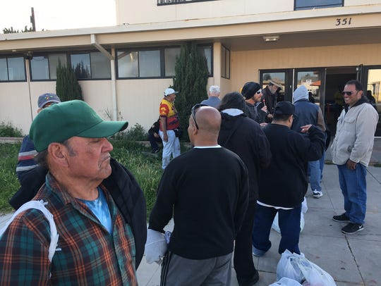 People are seen in this file photo waiting to get into the winter shelter, held at the Oxnard National Guard Armory.