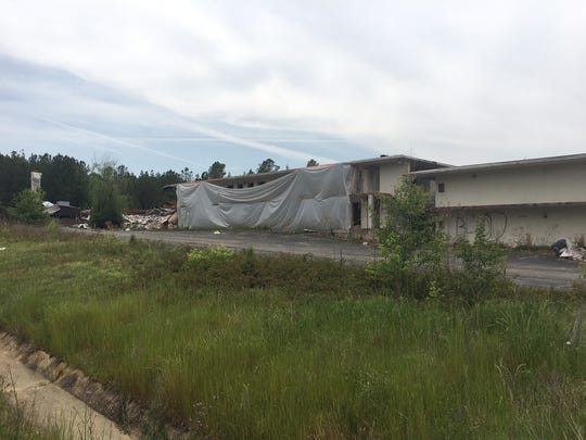 Demolition of the old Knights Inn began in the summer of 2015. It was halted shortly after and the partially demolished sections have stood since.