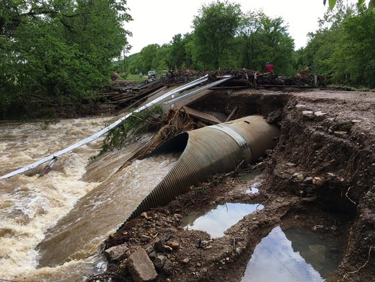 Water rushes under the what is left of the Denton Ferry Road bridge in April following the torrential rainfall that flooded the Twin Lakes Area. The county is still waiting to be reimbursed by FEMA for the bridge's repairs, County Judge Mickey Pendergrass said.