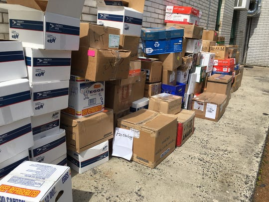 About 100 boxes of books are being shipped from Plainfield