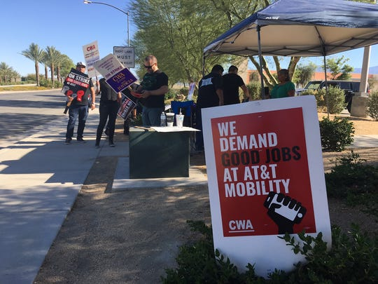 Striking AT&T workers demonstrate along Jackson Street in Indio on May 19, 2017.
