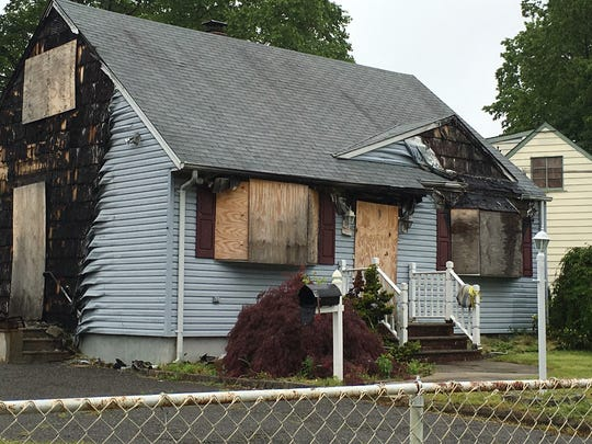 Home on Florence Place, South Plainfield, that was heavily damaged by May 26, 2016 fire in which a woman was rescued.