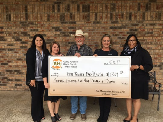 Belinda Longoria, Lisa Fenton, Lezlie Sifuentes and Shawnta Griffin, representing the Curry Junction, Riatta Ranch, Timber Ridge, and BH Management apartment complexes, present Kerry Fortune (center), president of Ben Richey Boys Ranch & Family Program, with a donation of $1,309.38. The funds were raised at the annual BH Management Charity Volleyball Tournament.
