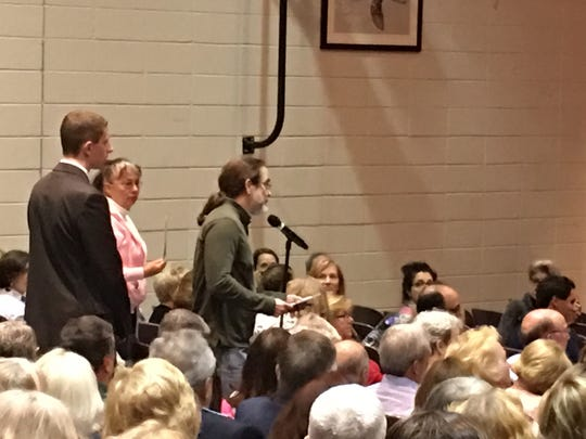 An audience member ask questions during U.S. Rep. Leonard