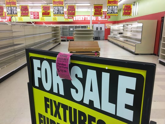 """A """"for sale"""" sign inside the Marsh on Hoyt Avenue in"""
