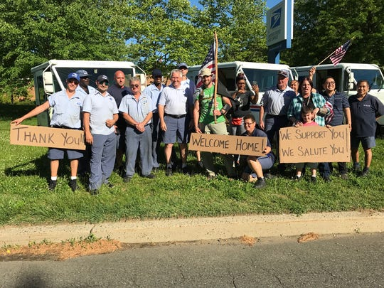 Holmdel Police Officer and veteran Michael Dowens was greeted by many in East Brunswick on Saturday as he completed his walk to raise awareness and funds for veterans with post-traumatic stress disorder.