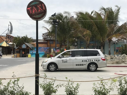 A cab from Nite Club Taxi waits for a fare outside Seacrets in Ocean City. The town council has enacted a taxi medallion buyback program to reduce the number of cabs operating in the resort, in the hopes of giving them a business edge over rival services like Uber and Lyft.