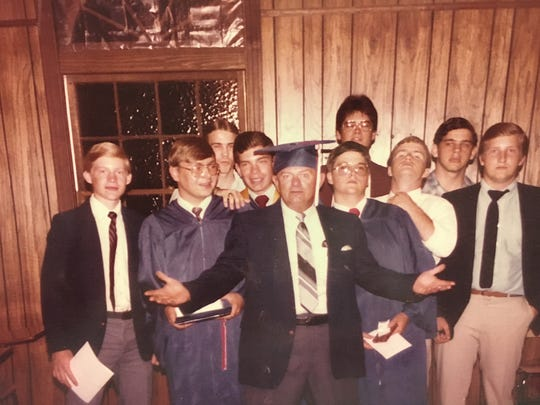 Dad, center (obviously), mugging for the camera during my high school graduation in 1985.