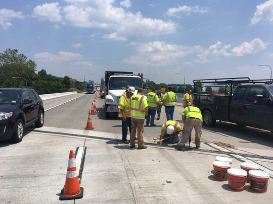 "Crews do a temporary fix on a span of I-495 southbound that travel over U.S. 13.  A DelDOT official said the joint ""popped out of place""."