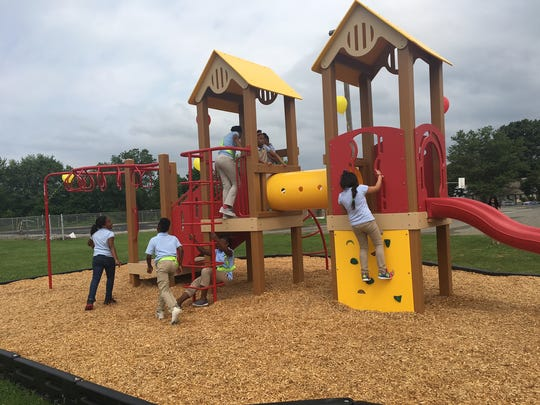 """Students at Hawthorne Park Elementary School play on their new playground made from recycled oral care waste. The received it for winning the 2016 """"Recycled Playground Challenge."""""""
