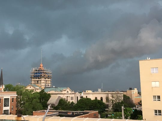 Storm clouds roll in above the Brown County Courthouse in Green Bay Wednesday afternoon. The region was briefly under a tornado warning.