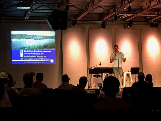 Henz gives a presentation during MonsoonCon at the