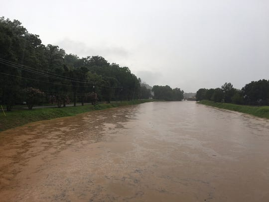 Autauga Creek runinng bank to bank in Downtown Prattville on Sunday morning.