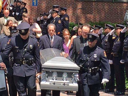 636334833930209019-Linden-casket-carried-from-church.jpg