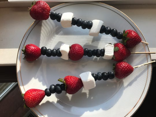 Red, white and blue skewers are made with berries and marshmallows (or cubes of pound cake).